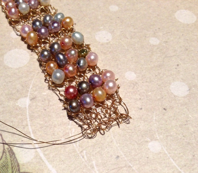 Insert tails thru live stitches; cover with ribbon clasp