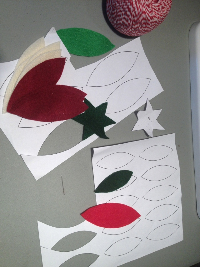 the printed templates and felt pieces cut with them